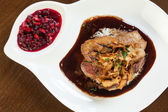 Delicious duck breast dish with gravy and rice — Stock Photo