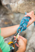 Female rock climber adjusting her harness — Stock Photo