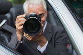 Mature paparazzi spying — Stock Photo