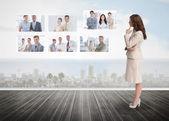 Businesswoman staring at futuristic interface — Stock Photo