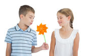 Peaceful brother and sister playing with pinwheel — Stock Photo