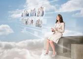 Businesswoman using futuristic interface — Stock Photo