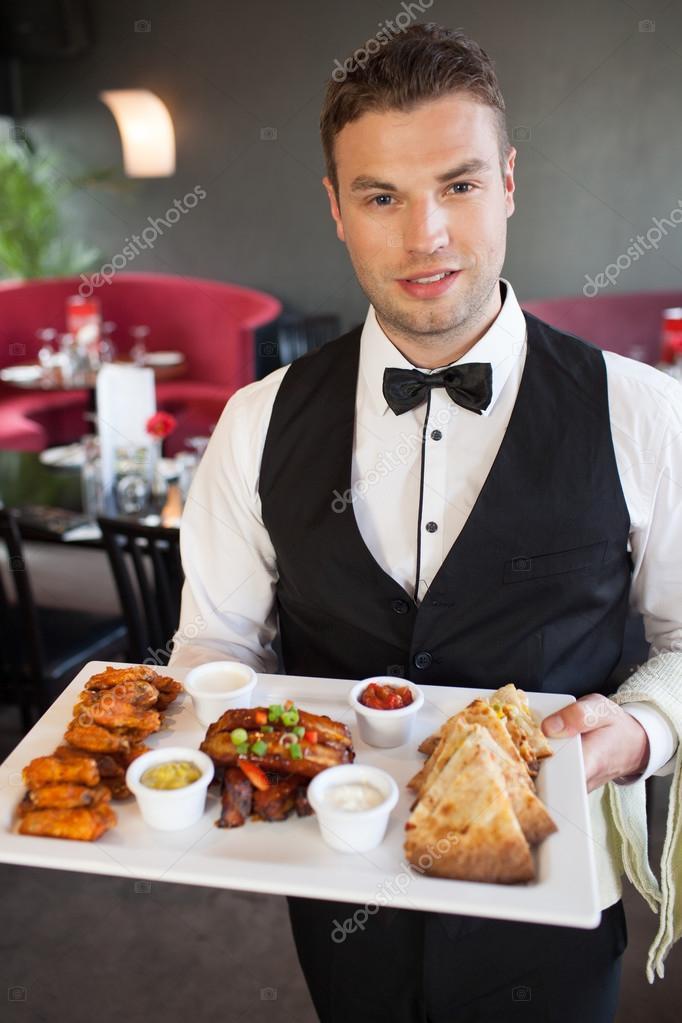 depositphotos_31466055-Handsome-waiter-serving-appetizing-finger-food-platter