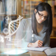 Focused mature student studying medicine on digital interface — ストック写真