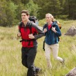 Happy couple setting out on a hike — Stock Photo #31470365