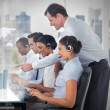 Stock Photo: Call center employees at work on futuristic interfaces showing map and graph