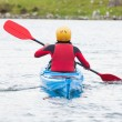 Woman rowing in a kayak — Stockfoto