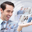 Joyful businessman looking at pictures — Stockfoto
