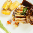 Delicious rack of lamb dish with roast vegetable and potatoes — Stock Photo