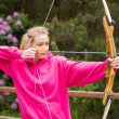 Stock Photo: Concentrating blonde practicing archery