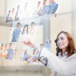 Pleased businesswoman selecting pictures — Stock Photo #31471177