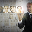 Stern businessman choosing future employees — Stock Photo