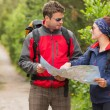 Stock Photo: Fit couple going on hike together looking at map