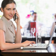 Businesswoman calling on phone using laptop — Stock Photo #31471483
