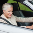 Smiling businesswomdriving classy car — Stock Photo #31471485