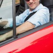 Cheerful handsome man driving his red convertible — Foto de Stock