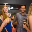 Laughing friends drinking beers — Stock Photo
