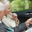 Business people working together in classy cabriolet — Stock Photo