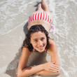 Stock Photo: Brunette lying down on beach