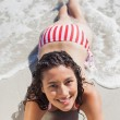 Stock Photo: High angle view of smiling womlying down on beach