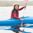 Happy woman rowing on lake — Stock Photo #31472939