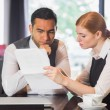 Serious business team working together in a cafe — Stock Photo