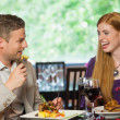 Cheerful couple eating together — Stock Photo