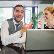 Stock Photo: Laughing business people working on laptop