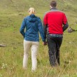 Couple holding hands and walking   — Stockfoto
