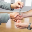 Close up of a handshake and a key delivery — Stock Photo #31474943