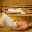 Calm couple relaxing in sauna — Stock Photo #31474987
