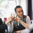 Happy business partners celebrating with champagne — Stock Photo #31475013