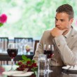 Handsome mwaiting for his girlfriend at restaurant — Stock Photo #31475149