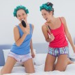 Girls having fun wearing pajama and hair rollers  — Stock Photo