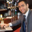 Smiling businessman working on his laptop — Stock Photo #31475655
