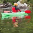 Man taking a break in his kayak — Stock Photo