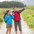 Hikers with backpacks standing on country trail — Stock Photo