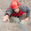 Stock Photo: Focused mclimbing rock face
