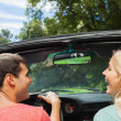 Rear view of cheerful couple in cabriolet — Stock Photo