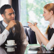 Stock Photo: Business people talking over coffee
