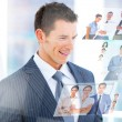 Stock Photo: Smiling businessmlooking at pictures