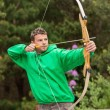 Stock Photo: Focused mpracticing archery