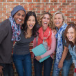 Smiling group of friends posing together — Stock Photo