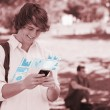 Happy student using his digital smartphone — Stock Photo #31477977