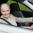 Cheerful businesswomdriving classy car — Stock Photo #31478105