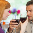 Handsome man having glass of wine with his pretty girlfriend — Stock Photo