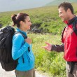 Hikers with backpacks chatting together — Stock fotografie