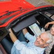 High angle view of cheerful mature man having a ride with his wife — Stock Photo #31478325