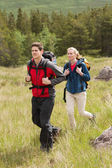 Happy couple setting out on a hike — Stock Photo