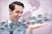 Cheerful businessman admiring a picture whirl — Stock Photo